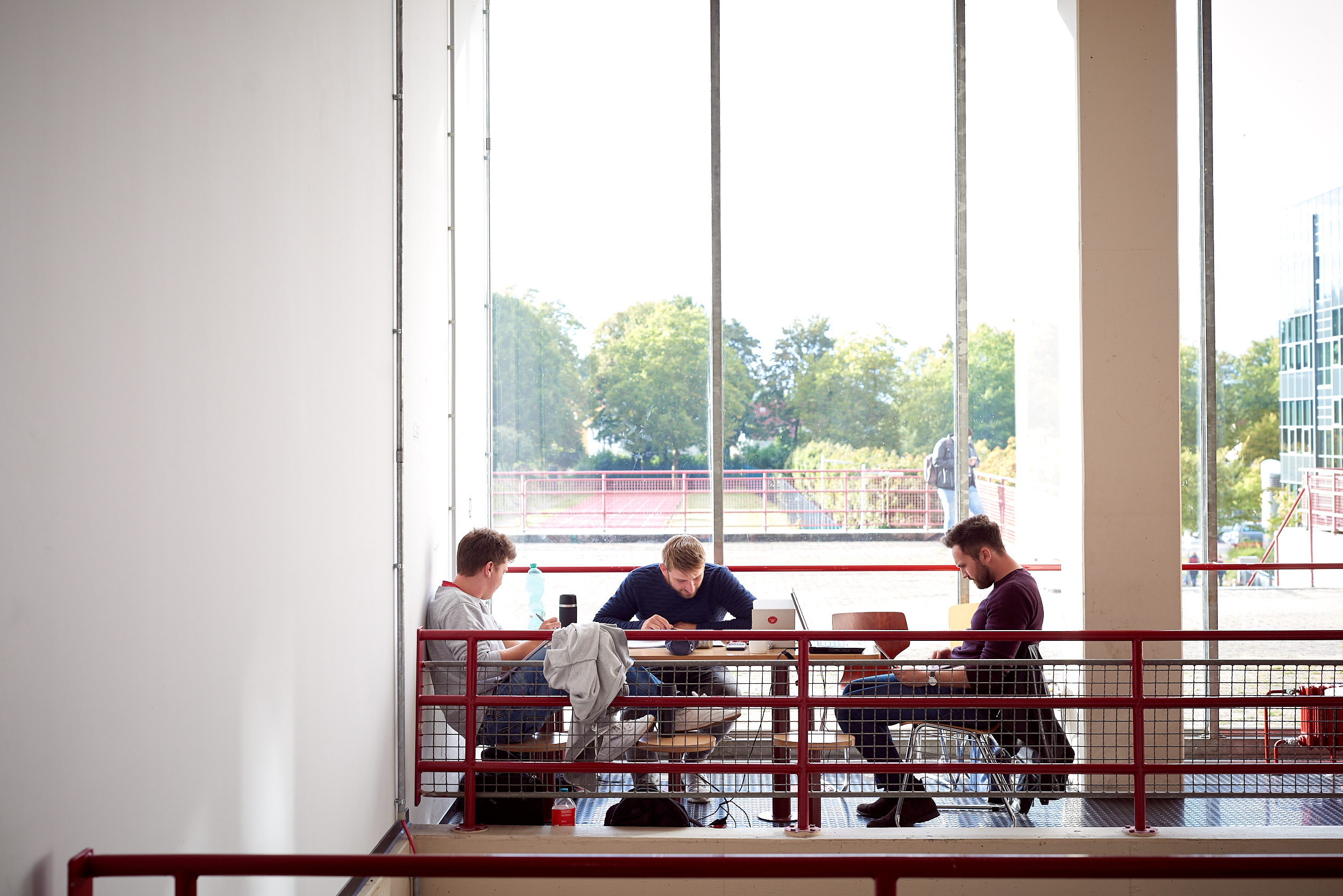 Students learning at one of the workplaces in the main building
